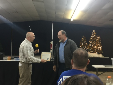 FCFSAB Christmas Dinner and Awards Ceremony--FC SAR Team Leader David Sutter presents Vernon Hofstedler, Team Leader of 'Christian Aid Minsteries SAR Team 10' with a Certificate of Recognition as 2018 Mutual Aid Partner of the Year. Team 10 is affiliated with the Amish/Mennonite Church located near Hunt in Johnson County. Some past recipients of this award have included: Ozark FD; Mulberry FD; St. Paul FD, and, the Crawford County SAR Team.