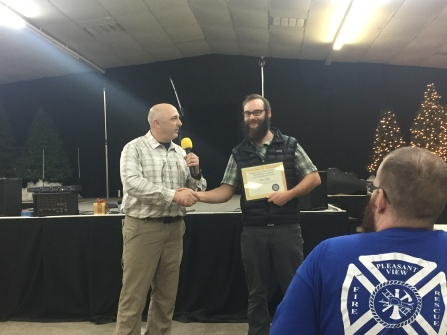 David Sutter presents Maxwell Miller with the SAR Volunteer of the Year Award